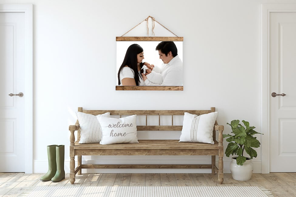 Rustic entryway with large hanging canvas over a wood bench
